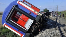 An overturned train car is seen near a village at Tekirdag province, Turkey Sunday, July 8, 2018. At least 10 people were killed and more than 70 injured Sunday when multiple cars of a train derailed in western Turkey, a Turkish official said. (Mehmet Yirun/DHA-Depo Photos via AP)