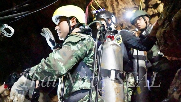 Rescue personnel work at the Tham Luang cave complex, as members of an under-16 soccer team and their coach have been found alive according to local media, in the northern province of Chiang Rai, Thailand July 4, 2018. Thai Navy Seal/Handout via REUTERS THIS IMAGE HAS BEEN SUPPLIED BY A THIRD PARTY. MANDATORY CREDIT. NO RESALES. NO ARCHIVES. - RC1634C2A510