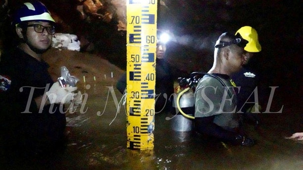 Rescue personnel work at the Tham Luang cave complex, as members of an under-16 soccer team and their coach have been found alive according to local media, in the northern province of Chiang Rai, Thailand July 4, 2018. Thai Navy Seal/Handout via REUTERS THIS IMAGE HAS BEEN SUPPLIED BY A THIRD PARTY. MANDATORY CREDIT. NO RESALES. NO ARCHIVES. - RC11E4793630