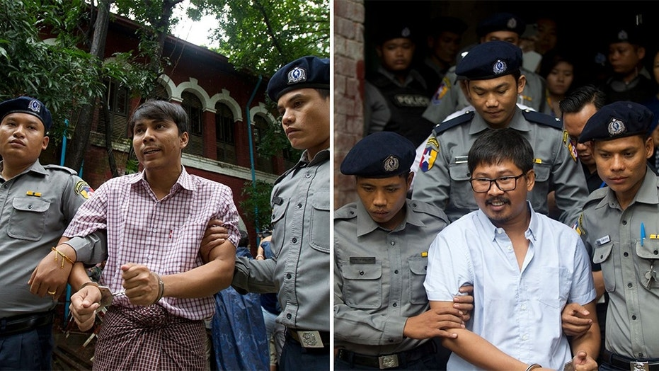 Reuters journalists Kyaw Soe Oo and Wa Lone will face trial in Burma; they are accused of illegally possessing official information. (Thein Zaw / The Associated Press)