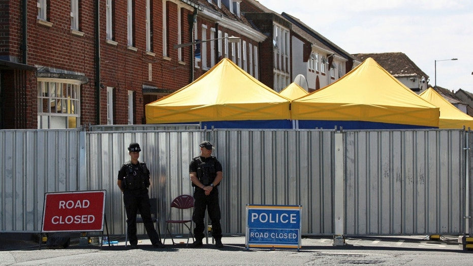 Police officers on duty in Salisbury, England, as the investigation into the death of Dawn Sturgess, who died after being exposed to nerve agent novichok, continues, Tuesday July 10, 2018.