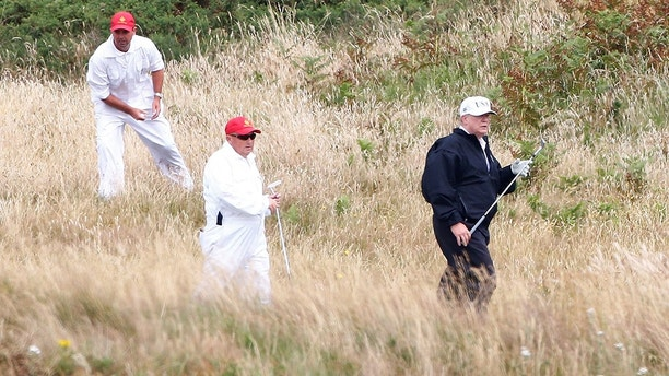 U.S. President Donald Trump carries a golf club at his golf resort, in Turnberry, Scotland  July 14, 2018.  REUTERS/Henry Nicholls - RC1DA88B9CE0
