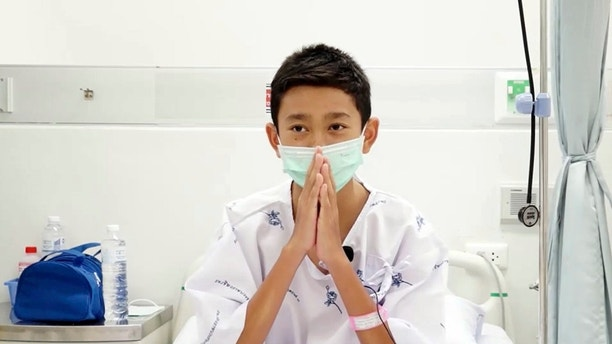 This image made from a video taken on July 13, 2018 and released by Chiang Rai Prachanukroh Hospital, show   s Nattavut Takhamsai, one of the 12 boys rescued from the flooded cave, in their hospital room at Chiang Rai Prachanukroh Hospital in Chiang Rai province, northern Thailand. The video was shown during a press conference at the hospital Saturday, July 14, 2018. (Chiang Rai Prachanukroh Hospital via AP)