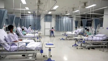 This image made from a video taken on July 13, 2018 and released by Chiang Rai Prachanukroh Hospital, shows some of the 12 boys rescued from the flooded cave, in their hospital room at Chiang Rai Prachanukroh Hospital in Chiang Rai province, northern Thailand. The video was shown during a press conference at the hospital Saturday, July 14, 2018. (Chiang Rai Prachanukroh Hospital via AP)