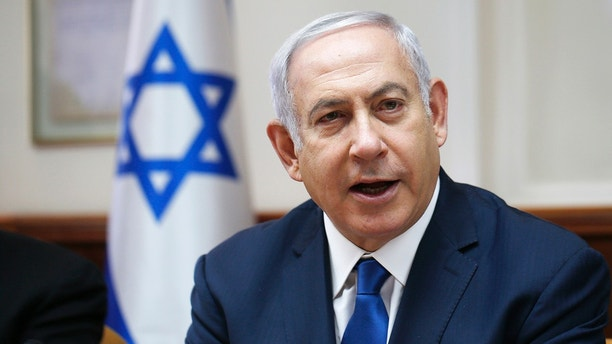 Israeli Prime Minister Benjamin Netanyahu attends the weekly cabinet meeting at his office in Jerusalem Sunday