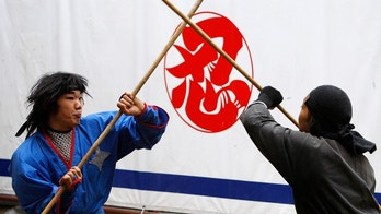 Ninja trainees Tomonosuke Ukita (L) and Masaunosuke Ukita  perform martial arts during a ninja festival in Iga, about  450 km (280 miles) from Tokyo, April 5, 2008.  The quiet city of 100,000 attracts almost 30,000 visitors for its annual ninja festival, which runs from April 1 to May 6 and features ninja-inspired dance performances, competitions, and opportunities to practise ninja skills. Picture taken April 5, 2008.   REUTERS/Kim Kyung-Hoon (JAPAN) - GM1E4480VQL01