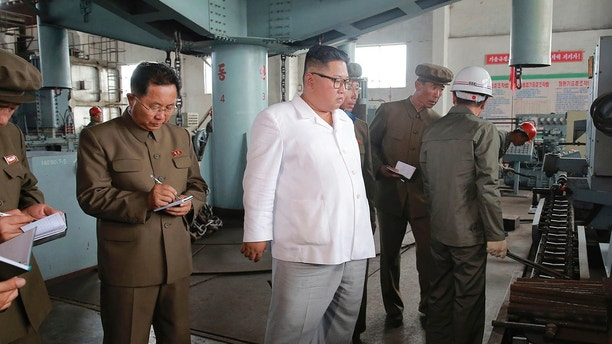 "In this undated photo provided on Tuesday, July 17, 2018, by the North Korean government, North Korean leader Kim Jong Un, center, visits a shipyard in North Hamgyong Province, North Korea. State media say that Kim has harshly reprimanded local officials over a delayed construction project. Independent journalists were not given access to cover the event depicted in this image distributed by the North Korean government. The content of this image is as provided and cannot be independently verified. Korean language watermark on image as provided by source reads: ""KCNA"" which is the abbreviation for Korean Central News Agency. (Korean Central News Agency/Korea News Service via AP)"