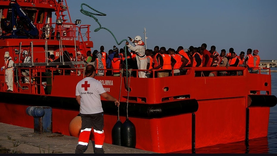 Migrants intercepted in the Mediterranean Sea are seen on a rescue boat upon arrival at the port of Malaga, southern Spain, on Wednesday.