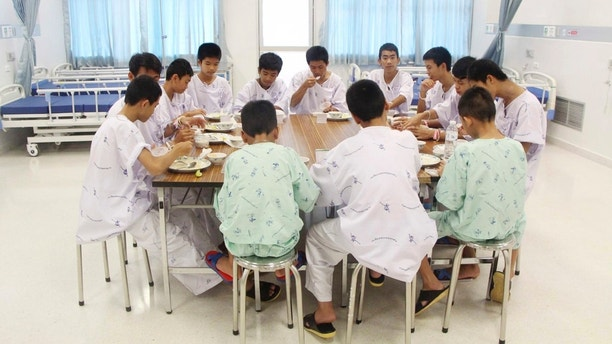 FILE - In this Sunday, July 15, 2018, file photo released by Thailand's Ministry of Health and the Chiang Rai Prachanukroh Hospital, some of the rescued soccer team members eat a meal together at a hospital in Chiang Rai, northern Thailand. The youth soccer teammates rescued from a flooded cave are expected to be released from the hospital Wednesday, July 18, 2018 and to speak about their ordeal. (Thailand's Ministry of Health and the Chiang Rai Prachanukroh Hospital, via AP, File)