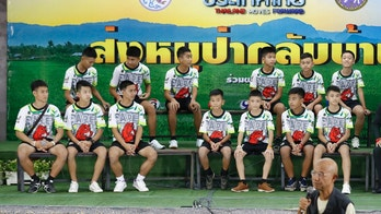 Members of the rescued soccer team and their coach sit during a press conference discussing their ordeal in the cave in Chiang Rai, northern Thailand, Wednesday, July 18, 2018. The 12 boys and their soccer coach rescued after being trapped in a flooded cave in northern Thailand are recovering well and are eager to eat their favorite comfort foods after their expected discharge from a hospital soon. (AP Photo/Vincent Thian)