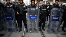 FILE - In this file photo dated Monday, April 16, 2018, Turkey's police officers look on as supporters of Turkey's main opposition Republican People's Party, CHP, gather to protest near central Istanbul's Taksim Square.  Turkey's controversial two-year-long state of emergency is scheduled to end at midnight Wednesday July 18, 2018, but the government is set to introduce new anti-terrorism laws it says are needed to deal with continued security threats. (AP Photo/Emrah Gurel, FILE)