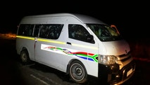 A minibus with bullet holes on its side is seen on the road between Weenen and Colenso, in KwaZulu Natal province, South Africa, early Sunday, July 22, 2018. South African police say gunmen opened fire Saturday night on the vehicle carrying members of a taxi drivers' association, killing 11 people and critically wounding four others. (Claudine Senegal/Ladysmith Herald via AP)