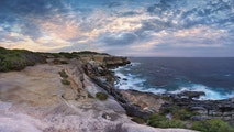 Scenic views north at Cape Solander.  Sydney Australia.  You would not want to have been standing on the cliff ledges when it gave way and crumbled onto the lower rock shelf and ocean