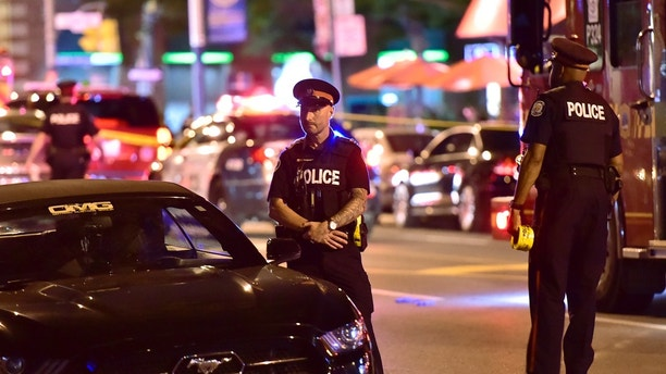 Police work the scene of a shooting in Toronto on Sunday, July 22, 2018. (Frank Gunn/The Canadian Press via AP)