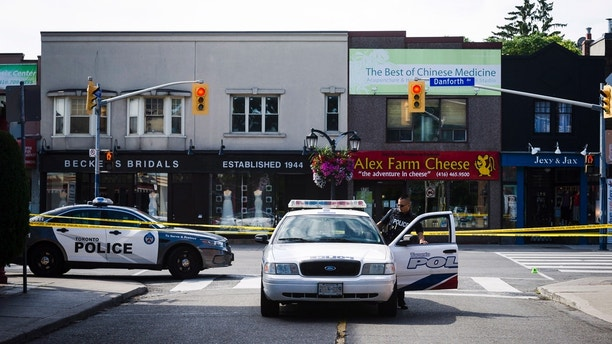Police work the scene of a shooting, Sunday, July 22, 2018, in Toronto. (Frank Gunn/The Canadian Press via AP)