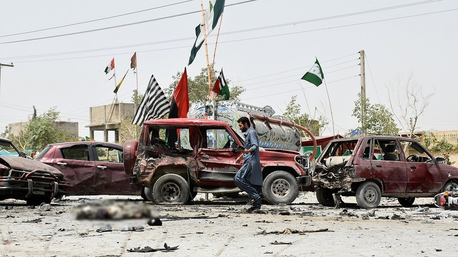 A member of the bomb disposal unit collects evidence from the site and captures the aftermath of a suicide blast in Quetta, Pakistan on July 25.