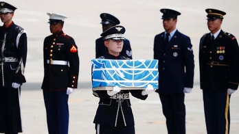 A soldier carries a casket containing a remain of a U.S. soldier who was killed in the Korean War during a ceremony at Osan Air Base in Pyeongtaek, South Korea, July 27, 2018.  The U.N. Command says the 55 cases of war remains retrieved from North Korea will be honored at a ceremony next Wednesday at a base in South Korea. A U.S. military plane flew to Wonsan, North Korea, on Friday to pick up what are believed to be the remains of U.S. servicemen killed in the Korean War. The transfer is meant to fulfill a commitment made by leader Kim Jong Un during his summit with President Donald Trump in June.(Kim Hong-Ji/Pool Photo via AP)