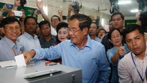 Cambodian Prime Minister Hun Sen, center, of the Cambodian People's Party casts his ballot in the country's general election at a polling station in Takhmua in Kandal province, southeast of Phnom Penh, Cambodia, Sunday, July 29, 2018. Cambodians have begun voting in an election virtually certain to return to office Prime Minister Hun Sen and his ruling Cambodian People's Party. (AP Photo/Heng Sinith)