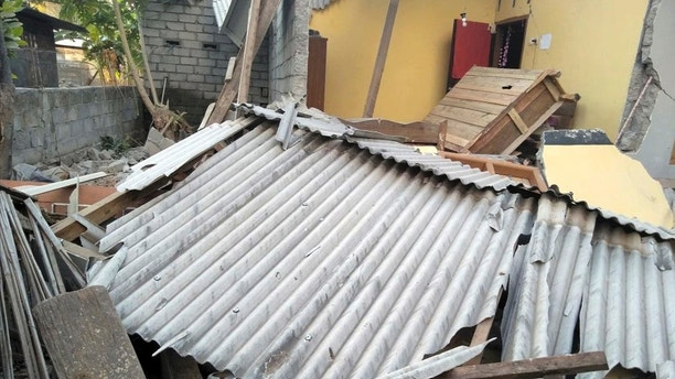 In this image made from video released by Indonesia's Disaster Mitigation Agency, damage caused by an early morning earthquake is seen on the island of Lombok, Indonesia, Sunday, July 29, 2018. A shallow magnitude 6.4 earthquake early Sunday killed a number people and injured dozens on Indonesia's Lombok Island, a popular tourist destination next to Bali. (Indonesia's Disaster Mitigation Agency via AP)