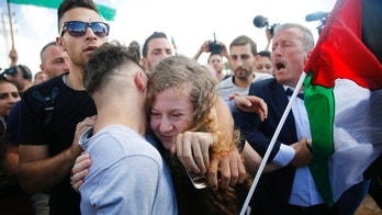 Ahed Tamimi is hugged after she was released by the Israel army in her village of Nebi Saleh in the West Bank Sunday, July 29, 2018. Palestinian protest icon Ahed Tamimi returned home to a hero's welcome in her West Bank village on Sunday after Israel released the 17-year-old from prison at the end of her eight-month sentence for slapping and kicking Israeli soldiers. (AP Photo/Nasser Shiyoukhi)