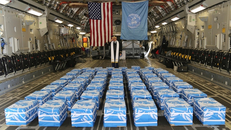 United Nations Command Chaplain U.S. Army Col. Sam Lee performs a blessing of sacrifice and remembrance on the 55 cases of remains believed to be U.S. servicemen killed during the Korean War and returned by North Korea at Osan Air Base in Pyeongtaek, South Korea, July 27, 2018.