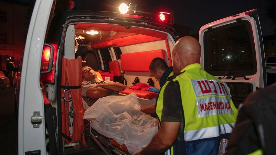 An injured man loaded into an ambulance after rocket fire from the Gaza Strip hit the town of Sderot, Israel, on Wednesday.