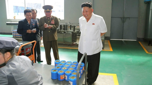 North Korean leader Kim Jong Un smiles during a visit to the Chonji Lubricant Factory, in this undated photo released by North Korea's Korean Central News Agency (KCNA) in Pyongyang August 6, 2014. REUTERS/KCNA (NORTH KOREA - Tags: POLITICS) ATTENTION EDITORS ? THIS PICTURE WAS PROVIDED BY A THIRD PARTY. REUTERS IS UNABLE TO INDEPENDENTLY VERIFY THE AUTHENTICITY, CONTENT, LOCATION OR DATE OF THIS IMAGE. FOR EDITORIAL USE ONLY. NOT FOR SALE FOR MARKETING OR ADVERTISING CAMPAIGNS. NO THIRD PARTY SALES. NOT FOR USE BY REUTERS THIRD PARTY DISTRIBUTORS. SOUTH KOREA OUT. NO COMMERCIAL OR EDITORIAL SALES IN SOUTH KOREA. THIS PICTURE IS DISTRIBUTED EXACTLY AS RECEIVED BY REUTERS, AS A SERVICE TO CLIENTS - GM1EA860S5Y01