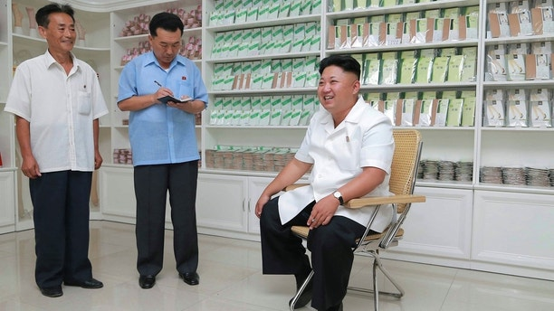 North Korean leader Kim Jong Un visits the Pyongyang Hosiery Factory, in this undated photo released by North Korea's Korean Central News Agency (KCNA) in Pyongyang August 7, 2014. REUTERS/KCNA (NORTH KOREA - Tags: POLITICS BUSINESS) 