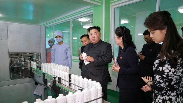 North Korean leader Kim Jong Un and wife Ri Sol Ju visit a cosmetics factory in this undated photo released by North Korea's Korean Central News Agency (KCNA) in Pyongyang on October 28, 2017. KCNA/via REUTERS   ATTENTION EDITORS - THIS PICTURE WAS PROVIDED BY A THIRD PARTY. REUTERS IS UNABLE TO INDEPENDENTLY VERIFY THE AUTHENTICITY, CONTENT, LOCATION OR DATE OF THIS IMAGE. NO THIRD PARTY SALES. SOUTH KOREA OUT. - RC14D2576D10