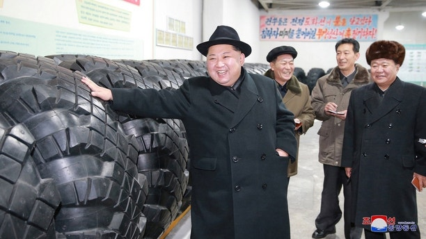 North Korea's leader Kim Jong Un inspects tires at a factory in this photo released by North Korea's Korean Central News Agency (KCNA) in Pyongyang December 3, 2017.  KCNA/ via REUTERS   ATTENTION EDITORS - THIS IMAGE WAS PROVIDED BY A THIRD PARTY. REUTERS IS UNABLE TO INDEPENDENTLY VERIFY THIS IMAGE. NO THIRD PARTY SALES. SOUTH KOREA OUT. - RC1961527E00