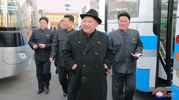 North Korean Leader Kim Jong Un Inspects A Newly Established Pyongyang Trackless Trolley Factory In This
