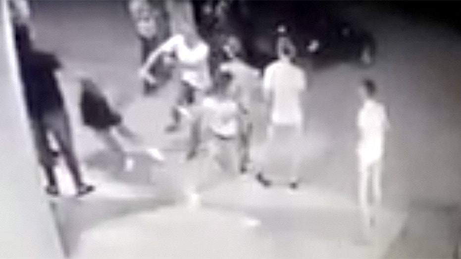 Surveillance video shows a Brazilian woman celebrating her birthday gunned down outside the party in an apparent gang retaliation attack.