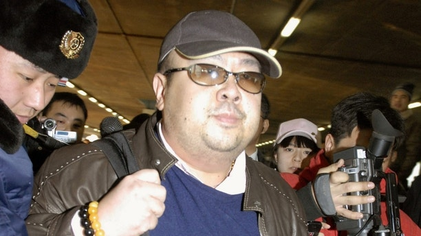 Kim Jong Nam arrives at Beijing airport in Beijing, China, in this photo taken by Kyodo February 11, 2007. Picture taken February 11, 2007. Mandatory credit Kyodo/via REUTERS ATTENTION EDITORS - THIS IMAGE WAS PROVIDED BY A THIRD PARTY. EDITORIAL USE ONLY. MANDATORY CREDIT. JAPAN OUT. NO COMMERCIAL OR EDITORIAL SALES IN JAPAN. THIS PICTURE WAS PROCESSED BY REUTERS TO ENHANCE QUALITY. AN UNPROCESSED VERSION HAS BEEN PROVIDED SEPARATELY. - RC12E9A0BED0
