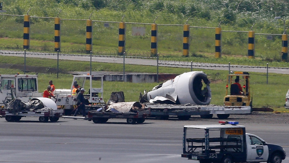 China's Xiamen Airlines plane skids off runway at Manila's airport