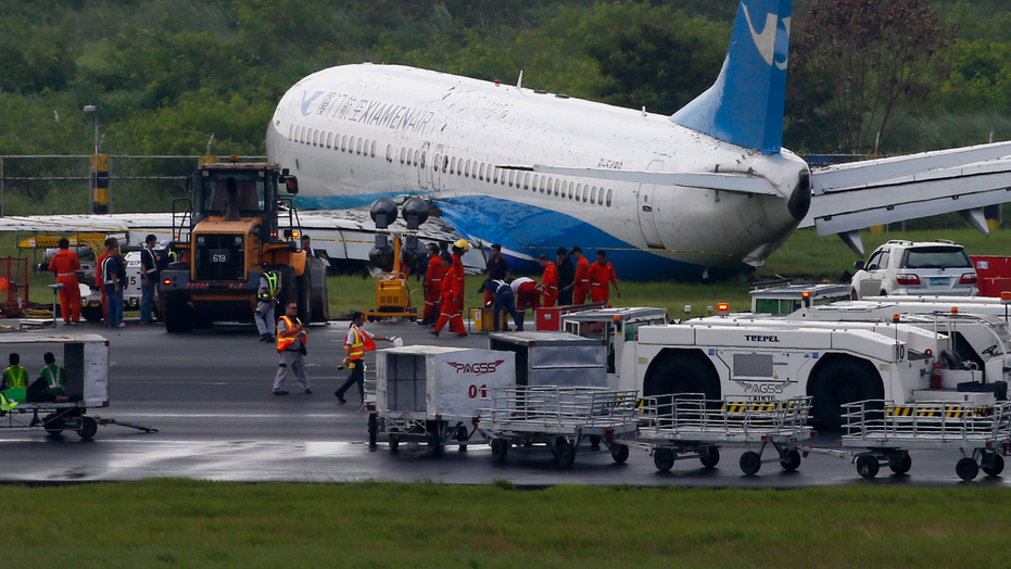 Xiamen Air flight skids off runway after landing at Manila airport