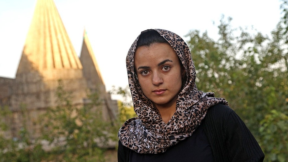 Yazidi woman Ashwaq Haji, allegedly used by the Islamic State group (IS) as a sex slave, visits the Lalish temple in tribute to the jihadists' victims from her northern Iraq village of Kocho on Wednesday.