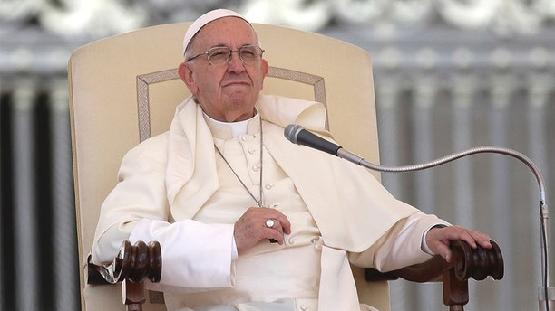 Pope Francis sits during his weekly general audience in St. Peter's Square at the Vatican, Wednesday, May 16, 2018. Pope Francis warned Wednesday that the latest spasm of violence in the Holy Land is only hurting chances for peace, and called for revived efforts at dialogue and justice. (AP Photo/Alessandra Tarantino)