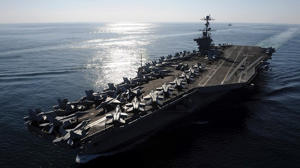 The Nimitz-class aircraft carrier USS John C. Stennis (CVN 74) transits the Strait of Hormuz, in this November 12, 2011 file photo. Iran's army chief told the United States that a U.S. aircraft carrier which left the area because of Iranian naval exercises should not return to the Gulf, the state news agency reported on Janurary 3, 2012.   REUTERS/U.S. Navy photo by Mass Communication Specialist 3rd Class Kenneth Abbate/Handout (MILITARY) FOR EDITORIAL USE ONLY. NOT FOR SALE FOR MARKETING OR ADVERTISING CAMPAIGNS. THIS IMAGE HAS BEEN SUPPLIED BY A THIRD PARTY. IT IS DISTRIBUTED, EXACTLY AS RECEIVED BY REUTERS, AS A SERVICE TO CLIENTS - GM1E81319GA01