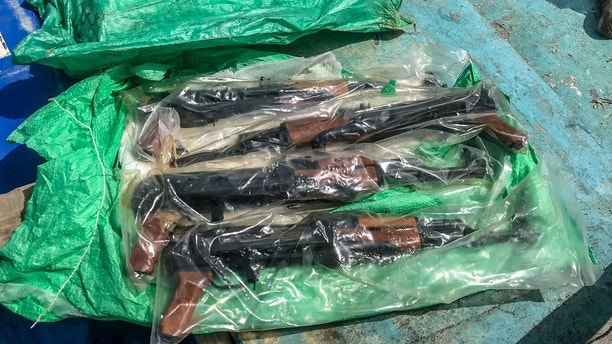 180828-N-N0146-6854 GULF OF ADEN (Aug. 28, 2018) A bag of AK-47 automatic rifles seized from a skiff by the guided-missile destroyer USS Jason Dunham's (DDG 109) visit, board, search and seizure team while conducting maritime security operations. The stateless skiff was found carrying a shipment of over 1,000 illicit weapons. Dunham is deployed to the U.S. 5th Fleet area of operations in support of naval operations to ensure maritime stability and security in the Central Region, connecting the Mediterranean and the Pacific through the western Indian Ocean and three strategic choke points. (U.S. Navy photo/Released)