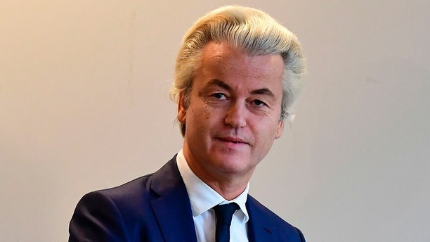 Netherlands' politician Geert Wilders (C) of the Freedom Party (PVV) casts his ballot for Dutch general elections at a polling station in The Hague on March 15, 2017. 