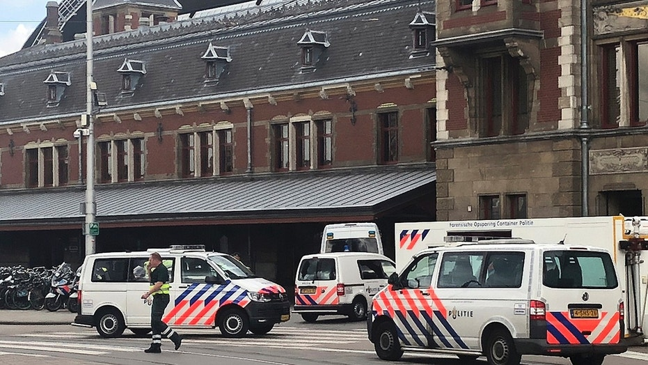 Suspect shot by police after double stabbing in Amsterdam station