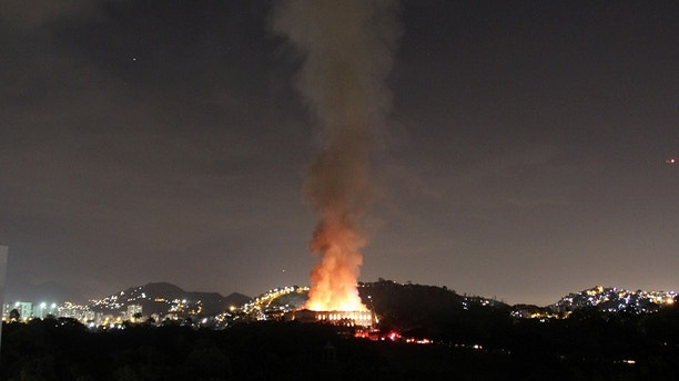 A fire rages at the National Museum of Brazil in Rio de Janeiro, Brazil September 2, 2018 in this photo obtained from social media. Tania Dominici / via REUTERS THIS IMAGE WAS SUPPLIED BY A THIRD PARTY. OBLIGATORY CREDIT. NO RISING. NO ARCHIVE. - RC19F32690F0