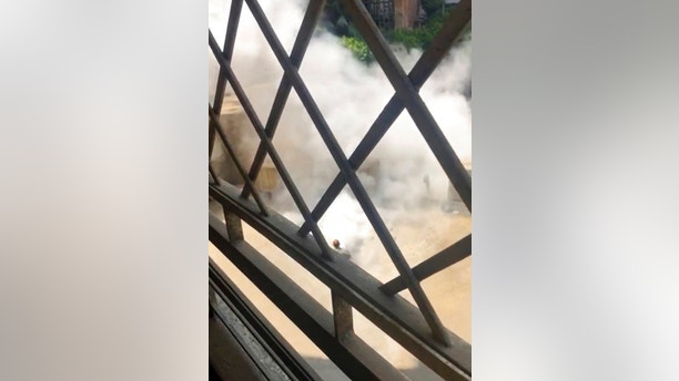 Smoke rises after a man carrying a crude explosive device exploded near the heavily fortified U.S. Embassy, Cairo, Egypt, Tuesday, Sept. 4, 2018. Officials said the man, whom they did not identify, was intercepted outside the concrete blast barriers that encircle the U.S. and nearby British embassies in the leafy district of Garden City. (Adel el-Adawy via AP)