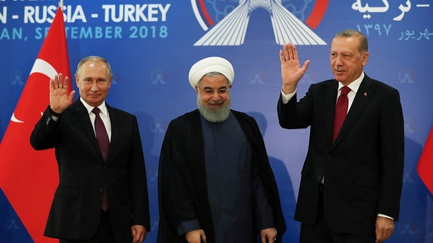 President Vladimir Putin of Russia, Hassan Rouhani of Iran and Tayyip Erdogan of Turkey meet in Tehran, Iran September 7, 2018. Kayhan Ozer/Turkish Presidential Palace/Handout via REUTERS ATTENTION EDITORS - THIS PICTURE WAS PROVIDED BY A THIRD PARTY. NO RESALES. NO ARCHIVE. - RC1A806216B0