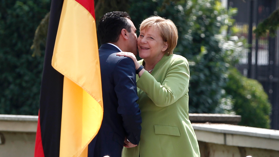"German Chancellor Angela Merkel, right, is welcomed by Macedonian Prime Minister Zoran Zaev upon her arrival at the government building in Skopje, Macedonia, Saturday, Sept. 8, 2018. German Chancellor Angela Merkel arrived to Macedonia Saturday, three weeks before the referendum for Macedonia's deal with neighboring Greece to change the country's name to ""North Macedonia"" that would facilitate country's EU and NATO accession. (AP Photo/Boris Grdanoski)"