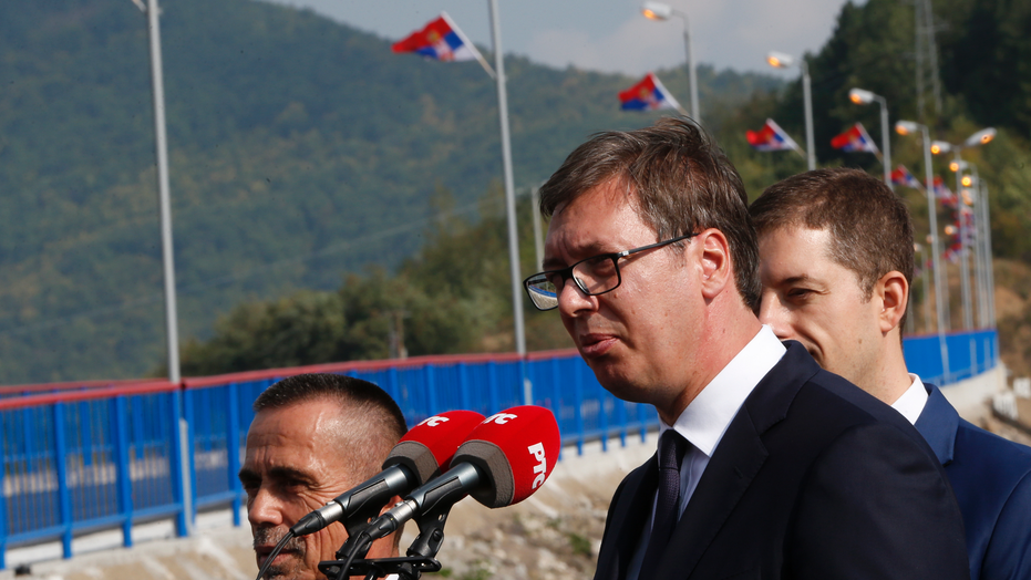 Serbian president Aleksandar Vucic, front, speaks during his visit to the Gazivode Dam near the village of Gazivode, Kosovo on Saturday, Sept. 8, 2018. Vucic is on a two day visit to Kosovo. (AP Photo/Visar Kryeziu)