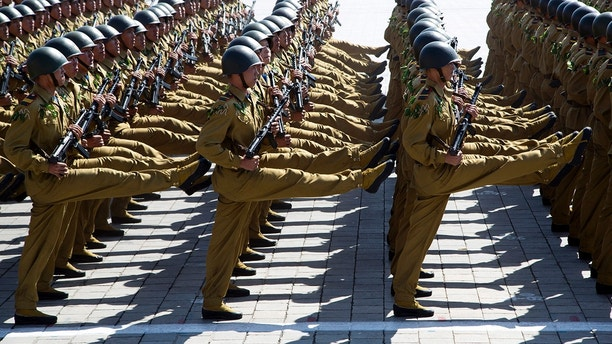 Soldiers march past during a parade for the 70th anniversary of North Korea's founding day in Pyongyang, North Korea, Sunday, Sept. 9, 2018. North Korea staged a major military parade, huge rallies and will revive its iconic mass games on Sunday to mark its 70th anniversary as a nation. (AP Photo/Ng Han Guan)