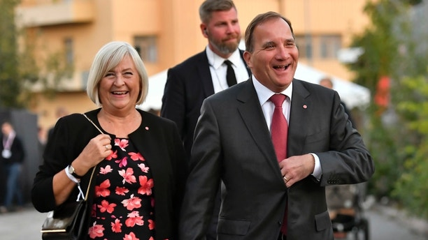 Swedish Prime Minister Stefan Lofven and his wife Ulla Lofven in Stockholm, Sweden, Sunday Sept. 9, 2018. An exit poll indicated that Sweden's first general election since the Scandinavian country accepted a significant number of asylum-seekers was likely to have the center-left party governing now as its winner, but an anti-immigrant party with white supremacist roots placing second in balloting Sunday. (Jonas Ekstromer/TT via AP)