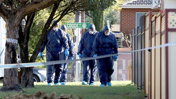 In this Sunday, Sept. 9, 2018 photo, forensic police officers inspect a property in suburban Perth, Australia. Three children, their mother and grandmother have been found dead in a house after a man alerted police, detectives said Monday. (AAP Image/Richard Wainwright)
