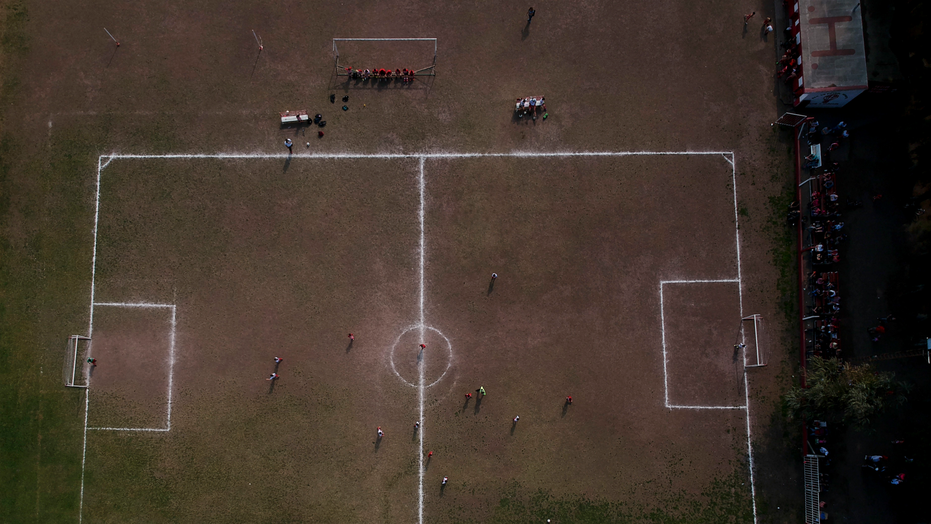 In this Sept. 8, 2018 photo, the Huracan de Chabas plays against Alumni, in Chabaz, Argentina. Two months ago, the regional soccer authorities notified Huracan that the team could no longer include Candelaria, a 7-year-old girl team member. She could only play on a girls' team, which does not exist where Candelaria lives. (AP Photo/Natacha Pisarenko)